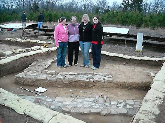 This photograph includes my group and our square during the excavation.  It serves as a reference to the size of each square and the depth of each layer.  The wall in the front is the one which we uncovered during our course.
