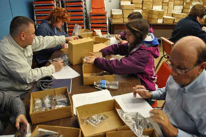 Members of the Memphis Archaeological and Geological Society inventory artifacts at the C.H. Nash Museum at Chucalissa.